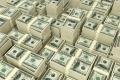 تبلغ ديون أمريكا 22 تريليون.. فلماذا لم يهتز عرش الدولار حتى الآن؟