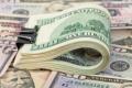 الدولار والدينار يواصلان التراجع