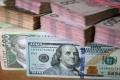 الدولار يتراجع على وقع المخاوف من فوز ترامب