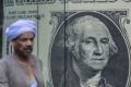 """الدولار يتجاوز 16 جنيهاً في البنوك المصرية.. والسوق مصابة بـ""""سكتة قلبية"""""""