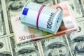 تحسن في أسعار صرف الدولار والدينار