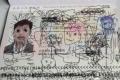 """صورة..أب عالق بين دولتين بسبب """"شخابيط"""" ابنه على جواز السفر"""