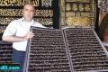 خطاط سوري يكتب القرآن الكريم بالخيط والابرة