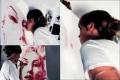 فنانة أمريكية تبدع بالرسم باستخدام الشفاه