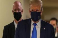 ترامب يرتدي الكمامة للمرة الأولى