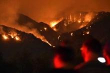 """الجحيم الأميركي"""" يستعر.. والحرائق التهمت 1.6 مليون فدان"""