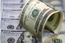 تحسن في سعر صرف الدولار والدينار