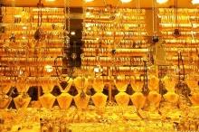 ضغوط الدولار تدفع الذهب لأكبر هبوط أسبوعي في أكثر من ...
