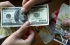 ارتفاع طفيف على الدينار وثبات الدولار