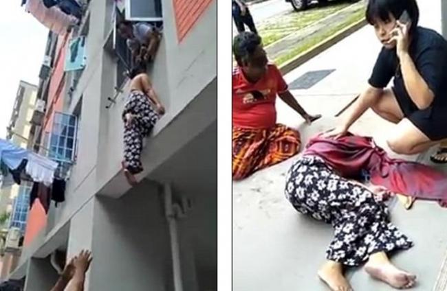 رجل يمسك امرأة من شعرها لمنع سقوطها من بناية
