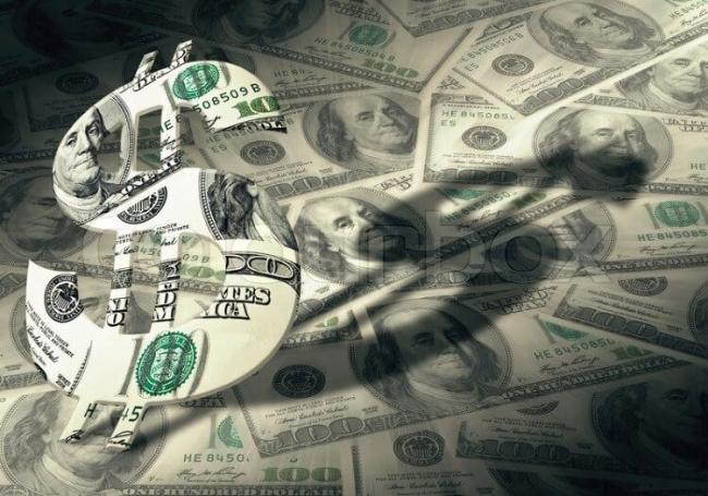 ما الأصل في رمز الدولار الأمريكي $ ؟؟